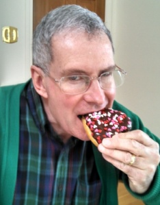 mr. ken eating a donut